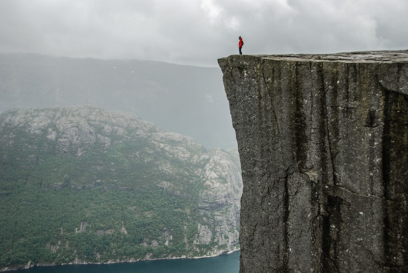 Man at top of the cliff