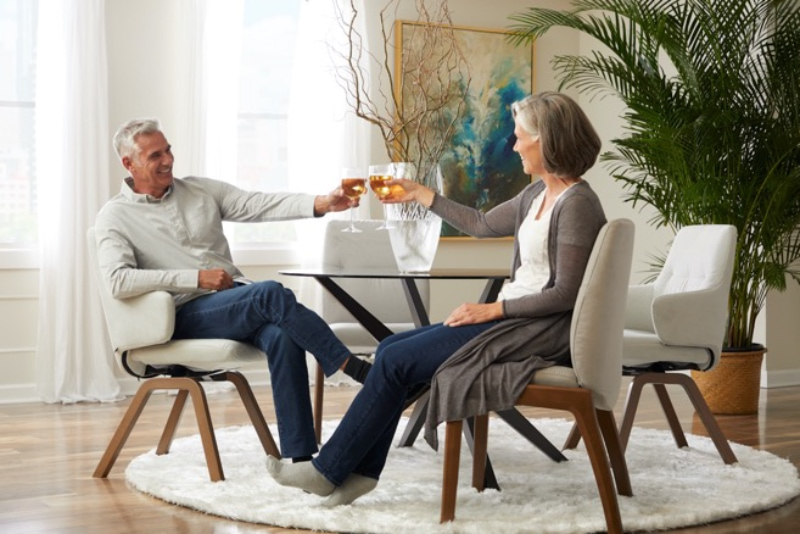 Couple toasting on stressless dining
